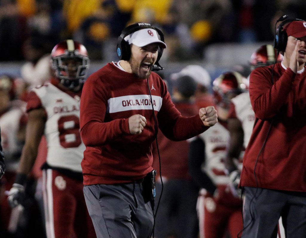 Oklahoma coach Lincoln Riley celebrates a touchdown during the first half of the team's NCAA college football game against West Virginia on Friday, Nov. 23, 2018, in Morgantown, W.Va. (AP Photo/Raymond Thompson)