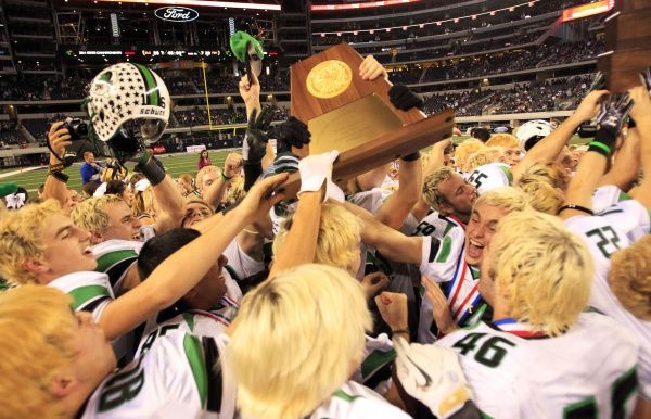 Southlake Carroll players celebrate with the championship trophy after beating Fort Bend Hightower in the Class 5A Division I state championship game in 2011.