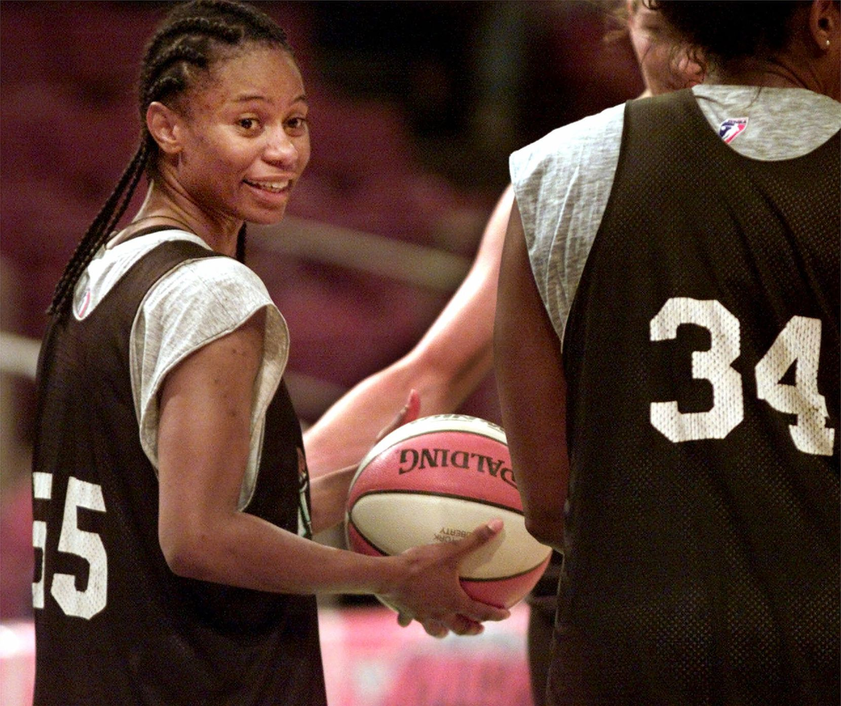The New York Liberty's leading scorer Vickie Johnson, left, talks to teammate Kym Hampton (34) during the team's practice, Tuesday, Aug. 24, 1999, at New York's Madison Square Garden.