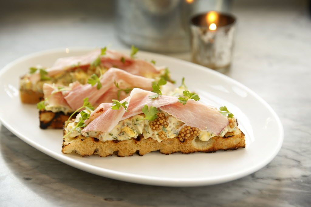 Deviled egg salad and ham on ciabatta toast