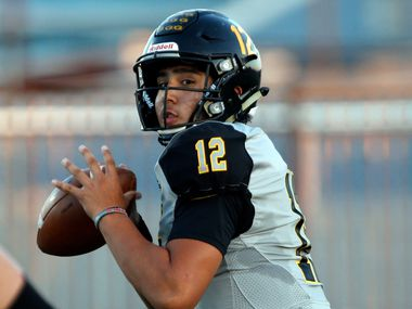 Garland high QB Cergio Perez (12) prepares to throw the football during the first half a high school football game against Wylie at Williams Stadium in Garland on Thursday, September 17, 2021.