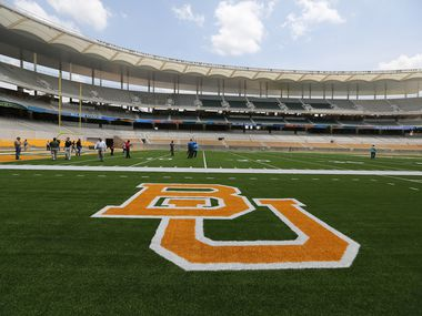 FILE — This Aug. 18, 2014 file photo shows the Baylor University logo on the football field at McLane Stadium in Waco, Texas.