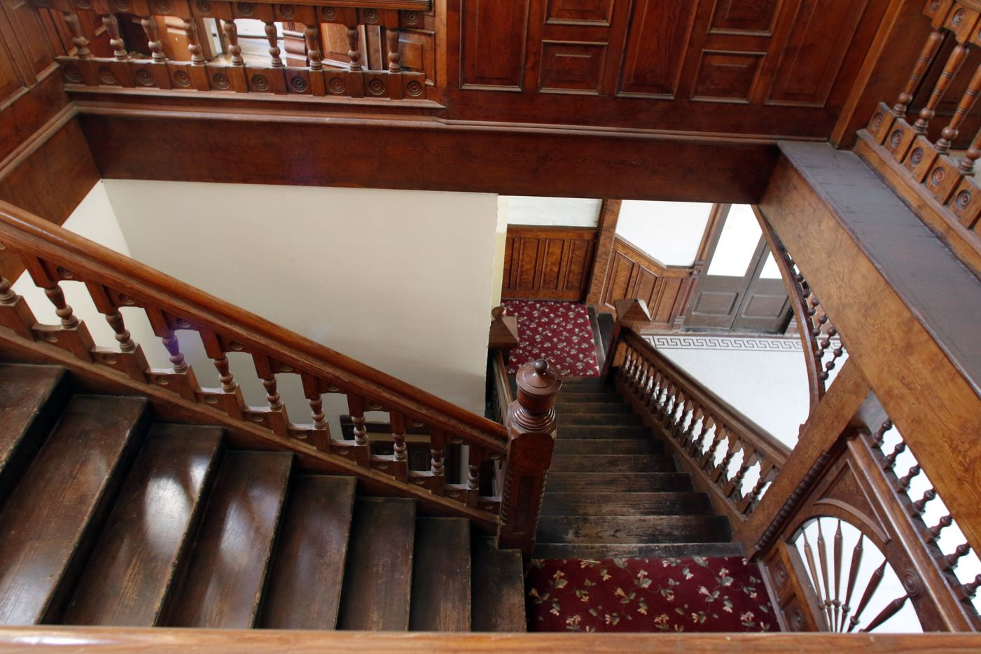 One of Alan Loudermilk's favorite features of the Ginocchio Hotel, a building he and his business partners are restoring, is the curly pine woodwork of its stairs. He imagines bridal parties posing for photos there.