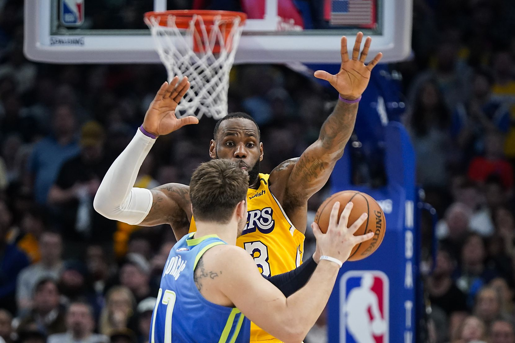 Los Angeles Lakers forward LeBron James (23) defends against Dallas Mavericks guard Luka Doncic (77) during the second half of an NBA basketball game at American Airlines Center on Friday, Jan. 10, 2020, in Dallas.