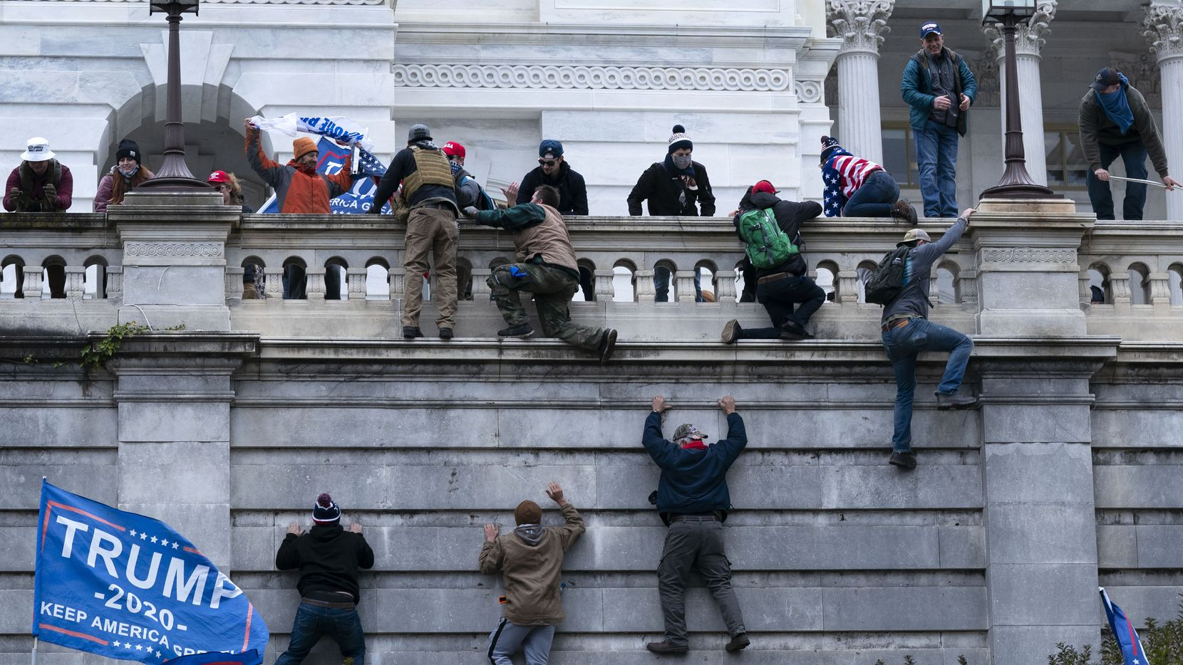 """A caption in Friday's Tyler Morning Telegraph falsely called the Trump supporters in this photograph """"members of antifa."""""""