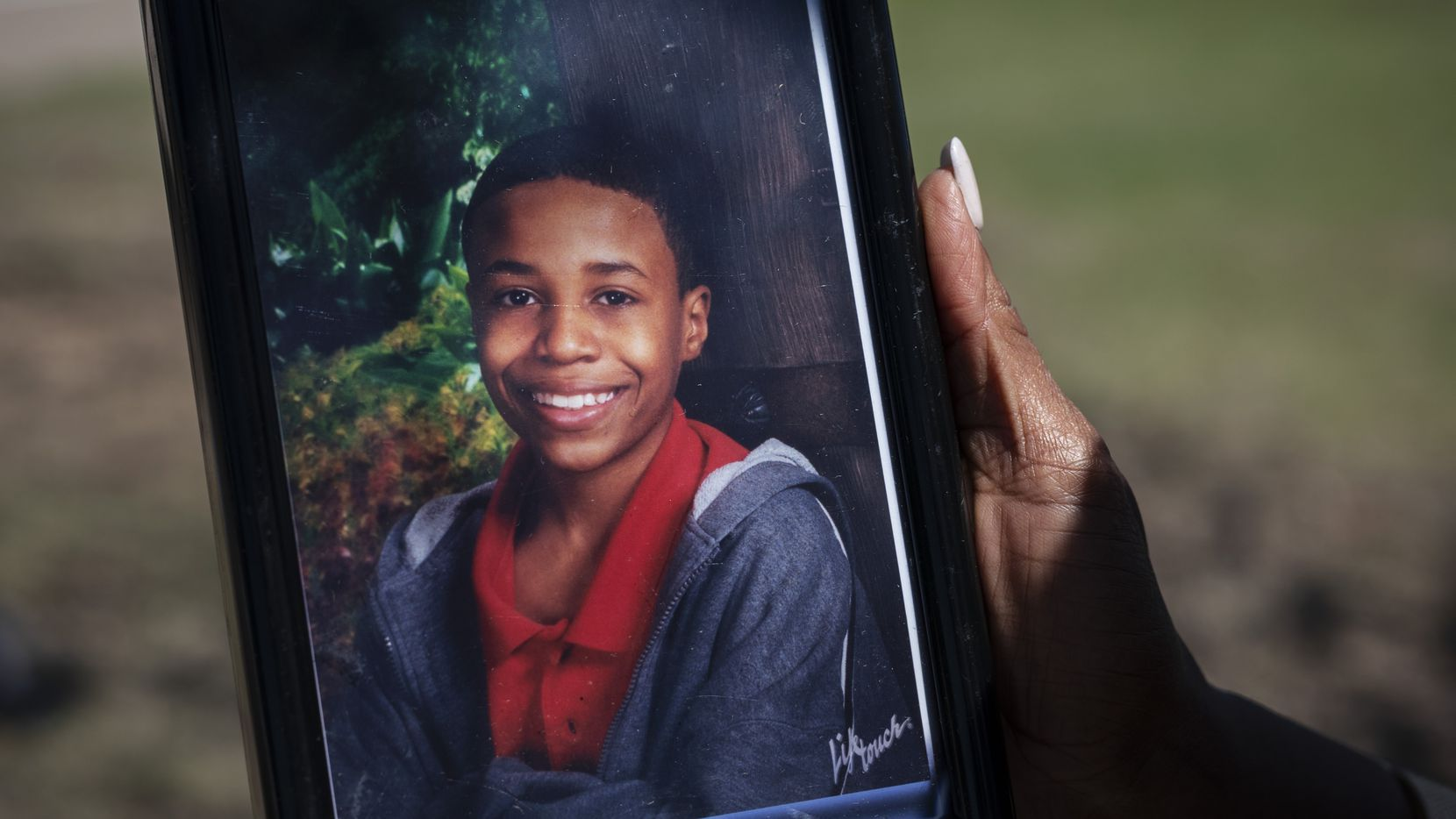 Donna Fields holds a photo of her son Marcus Bell Jr. Bell says that when he was 13, he was raped by Inspiring Body of Christ Church Pastor Rickie Rush. Fields and her sister say Rush also sexually abused them starting when they were teenagers.