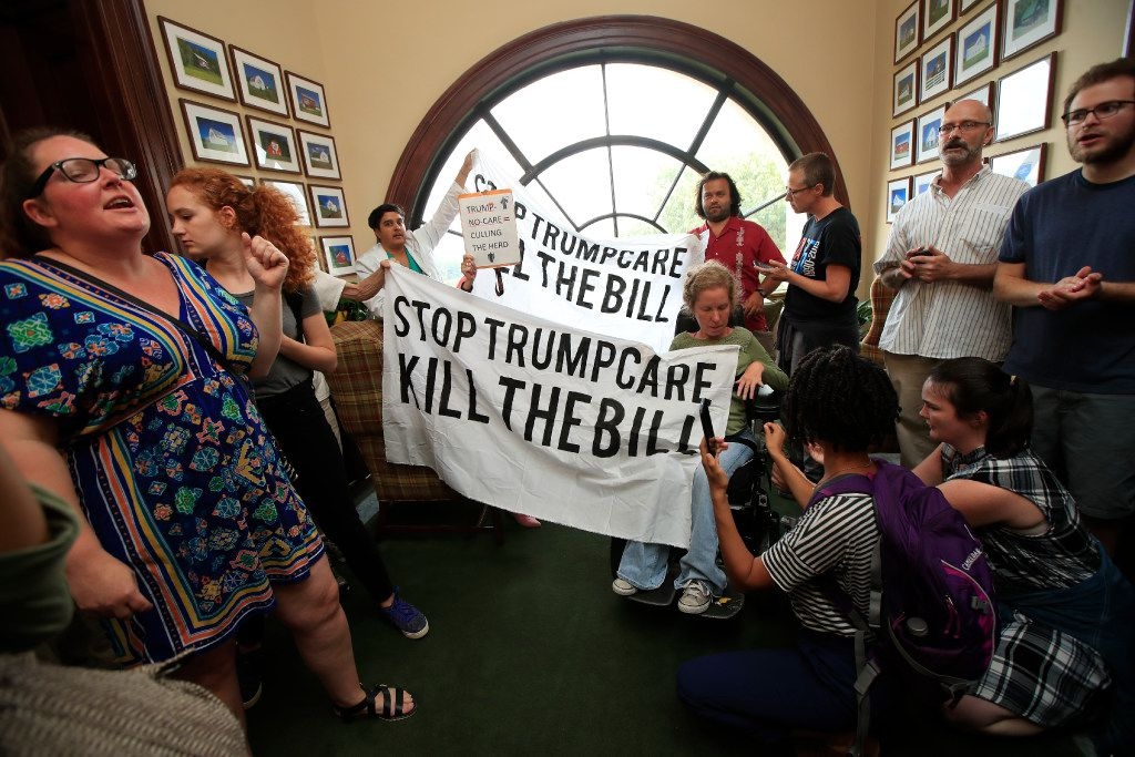 Protesters against the Republican health care bill gather inside the office of Sen. Rob Portman, R-Ohio, on Capitol Hill in Washington on Monday.