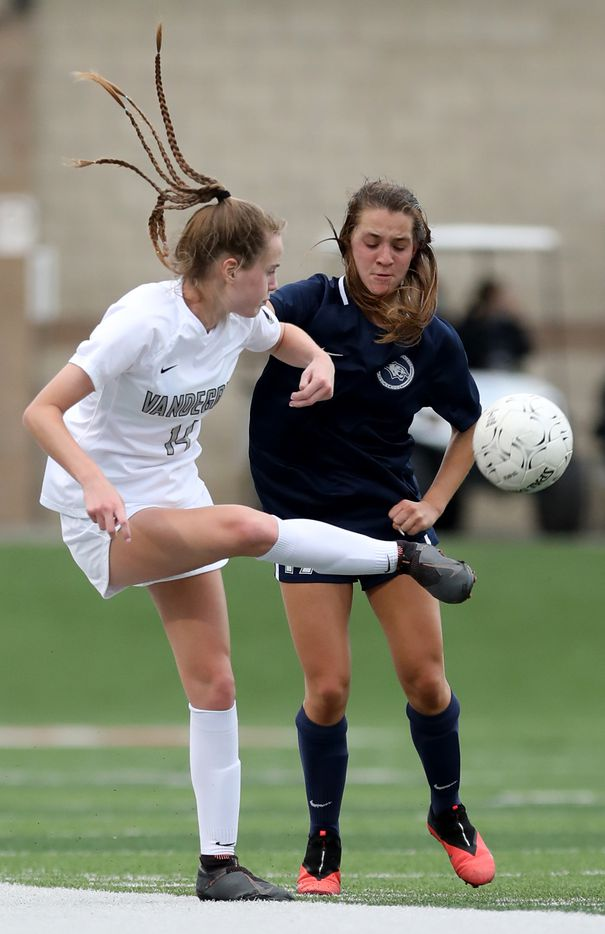 Austin Vandegrift's Lily Spencer (14) and Lewisville Flower Mound's Avery Simmons (17) go after the ball during their UIL 6A girls State championship soccer game at Birkelbach Field on April 16, 2021 in Georgetown, Texas. (Thao Nguyen/Special Contributor)