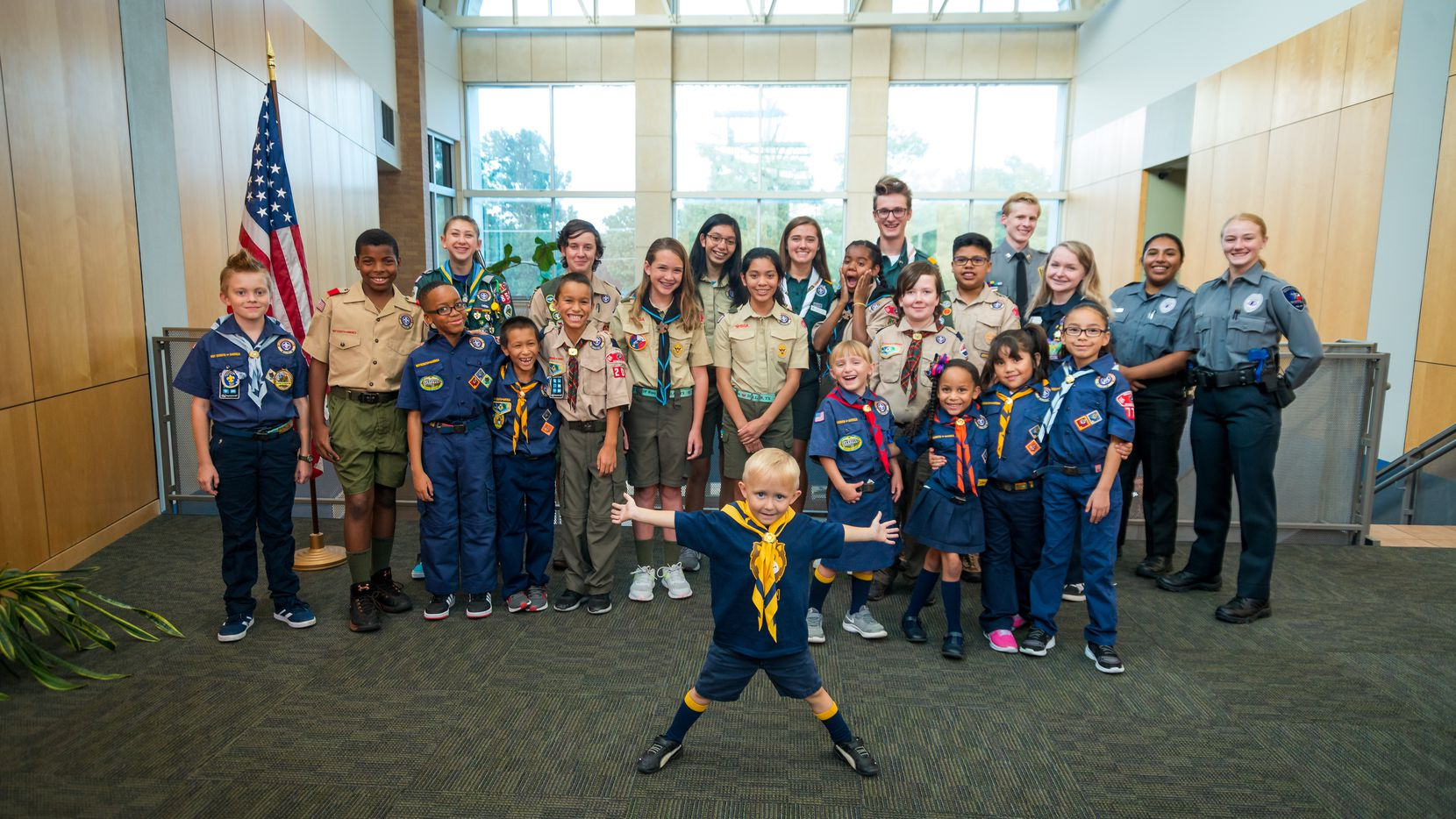 A group of Scouts across a range of ages pose for a photo together.