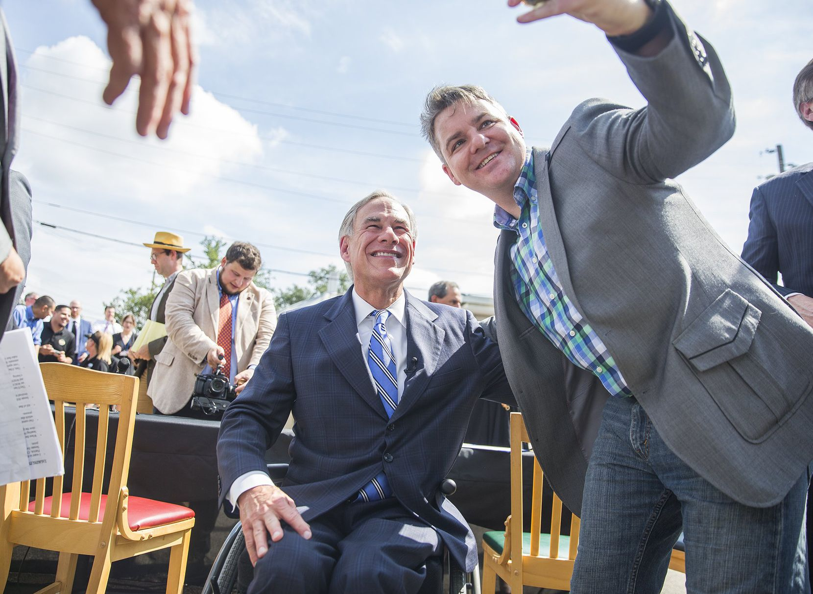 Nathaniel Mayfield takes a photo with Governor Greg Abbott after he signed a bill that limits property tax growth, Wednesday, June 12, 2019.