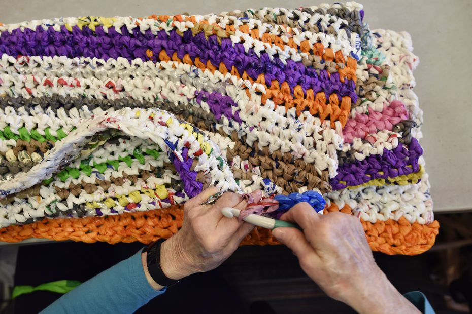 Gloria Little is among about a dozen crafters at CC Young Senior Living who gather every Monday to make sleeping mats out of old plastic shopping bags.