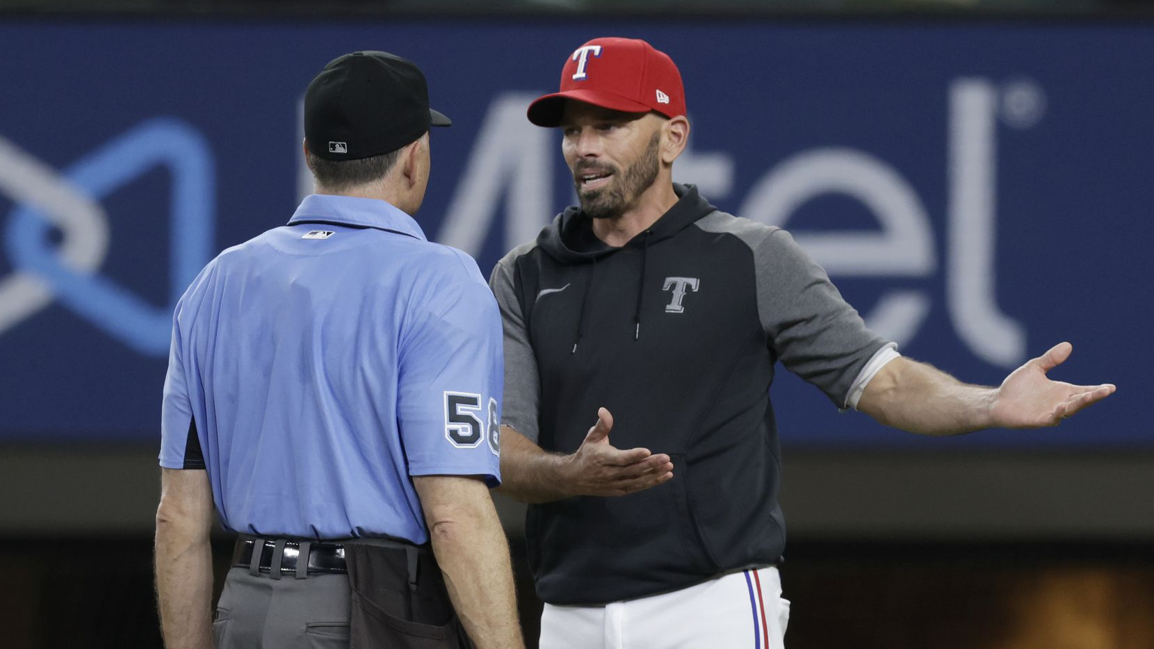 Texas Rangers manager Chris Woodward argues a call with home plate umpire Dan Iassogna during the sixth inning of a baseball game against the Oakland Athletics in Arlington, Monday, June 21, 2021. (Brandon Wade/Special Contributor)