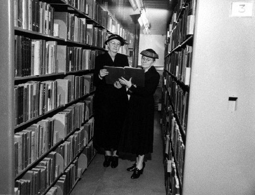 Mrs. Leonora Hall ( left) and Miss Edna Rowe, shown here reviewing a history of the  League of Women Voters at the Dallas Public Library, were among  the first women to register to vote in Dallas county. Dallas Public Library Historic Photograph Collection.