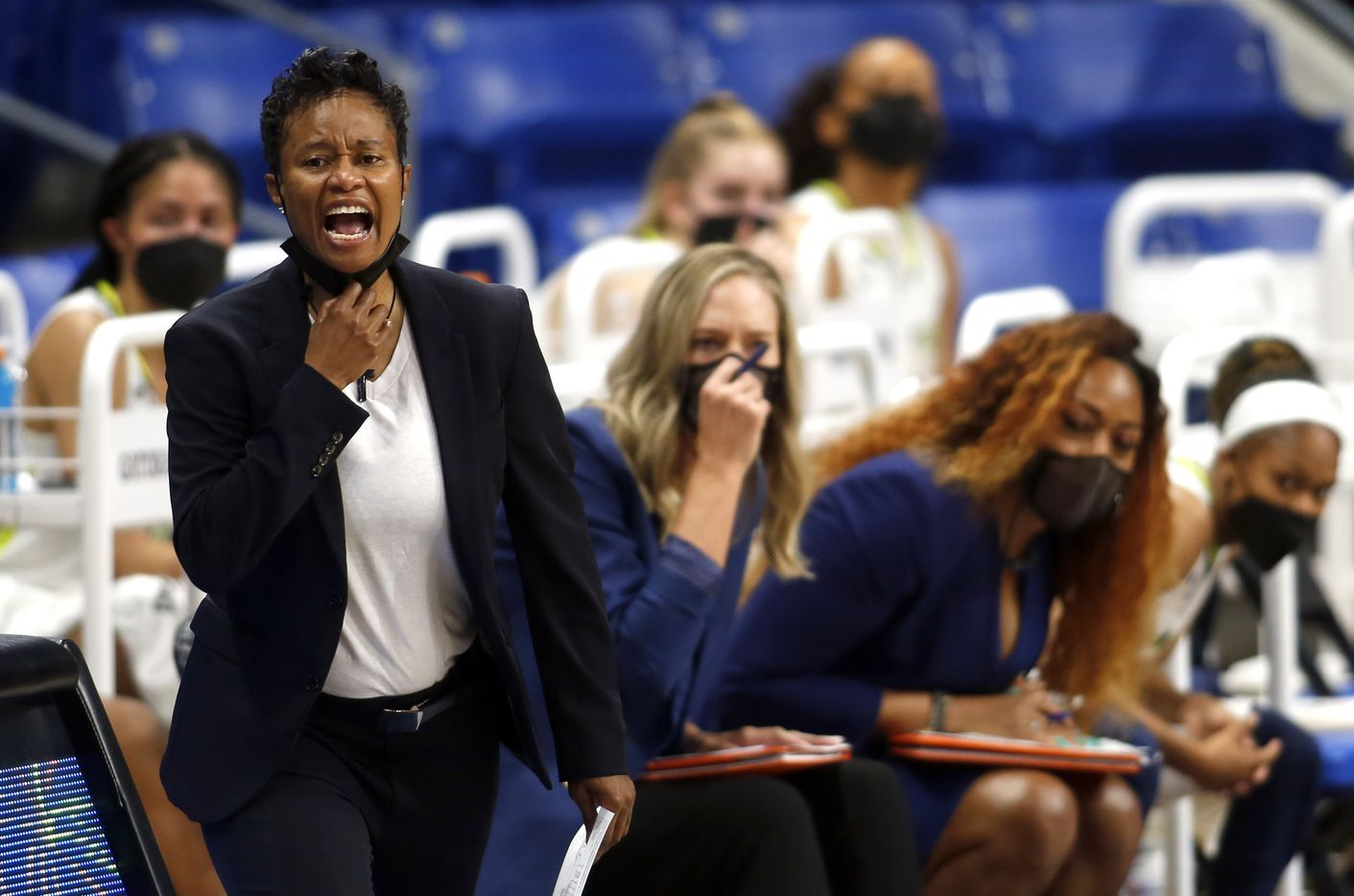Dallas Wings head coach Vickie Johnson directs her players from the team bench area during second half action against Seattle. The Wings hosted the Storm for their WNBA 2021season home opener at UTA's College Park Center in Arlington on May 22, 2021. (Steve Hamm/ Special Contributor)