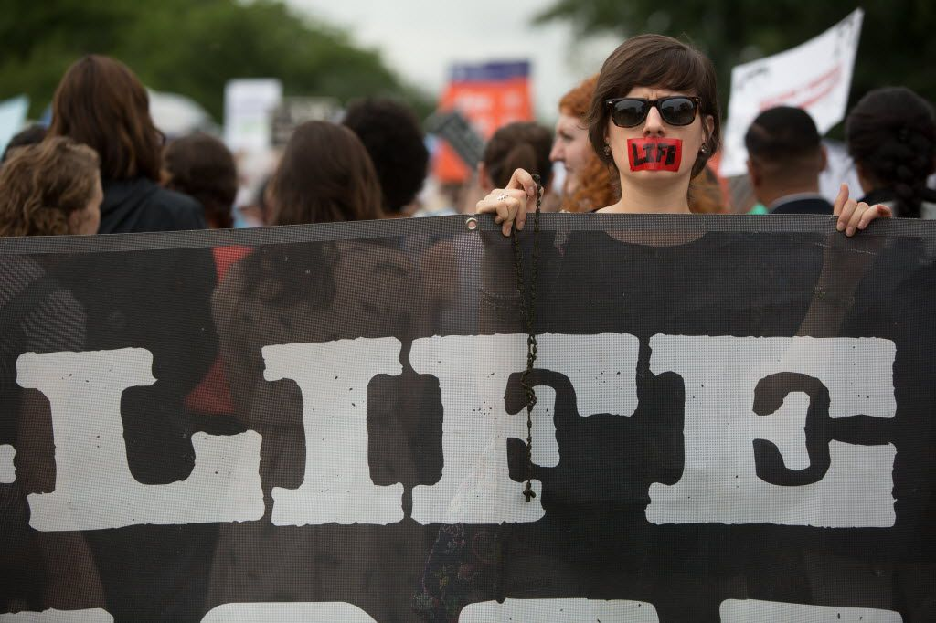 An abortion opponent protests in front of the U.S. Supreme Court. (Allison Shelley/Getty Images)