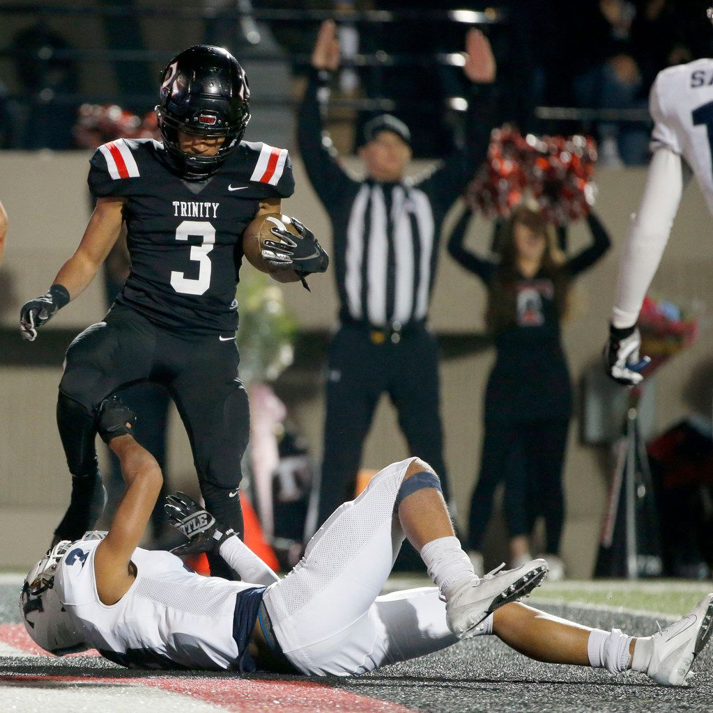 Euless Trinity's Zechariah Moore (3) scores a touchdown as Richland's  C.J. Baskerville (3) attempted the tackle during the first half of their high school football game on Friday Nov. 8, 2019. (Michael Ainsworth/Special Contributor)