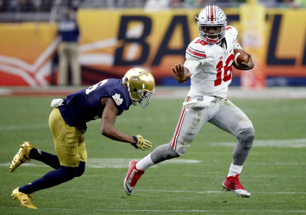 """FILE - In this Jan. 1, 2016, file photo, Ohio State quarterback J.T. Barrett (16) tries to elude Notre Dame cornerback Cole Luke during the second half of the Fiesta Bowl NCAA College football game, in Glendale, Ariz. """"He's having a great spring,"""" coach Urban Meyer said Monday, April 11, 2016. """"We're changing some things on him that we felt fundamentally he wasn't where he needed to be last year, for whatever reason. He's a fast player, and we need him to play as fast as he can.""""  (AP Photo/Ross D. Franklin, File)"""