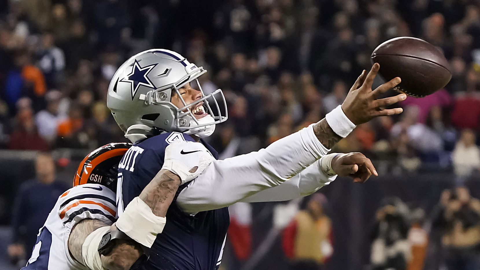 Dallas Cowboys quarterback Dak Prescott (4) tries to get off a pass as he is hit by Chicago Bears outside linebacker Aaron Lynch (99), resulting in a ruling of intentional grounding, during the second half of an NFL football game at Soldier Field on Thursday, Dec. 5, 2019, in Chicago. (Smiley N. Pool/The Dallas Morning News)