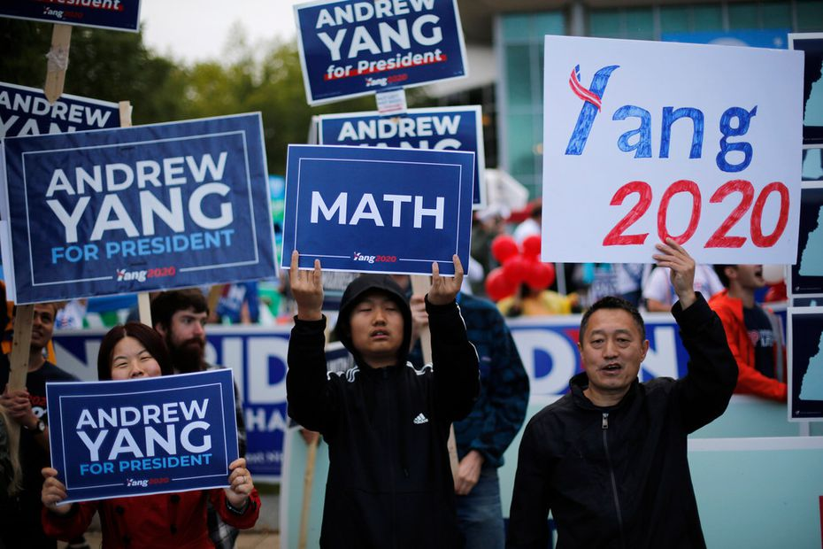 Supporters of businessman Andrew Yang rally before the New Hampshire state Democratic Party convention, Saturday, Sept. 7, 2019, in Manchester, NH.