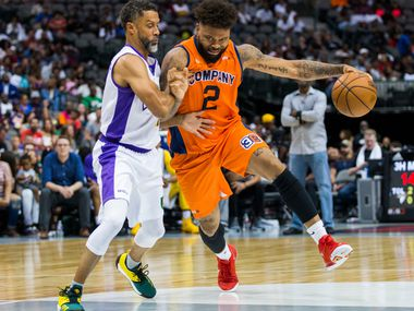 3's Company's Andre Emmett (2) gets around 3 Headed Monster's Mahmoud Abdul-Rauf (7) during a Big 3 playoff basketball game between 3's Company and 3 Headed Monster on Friday, August 17, 2018 at American Airlines Center in Dallas. (Ashley Landis/The Dallas Morning News)