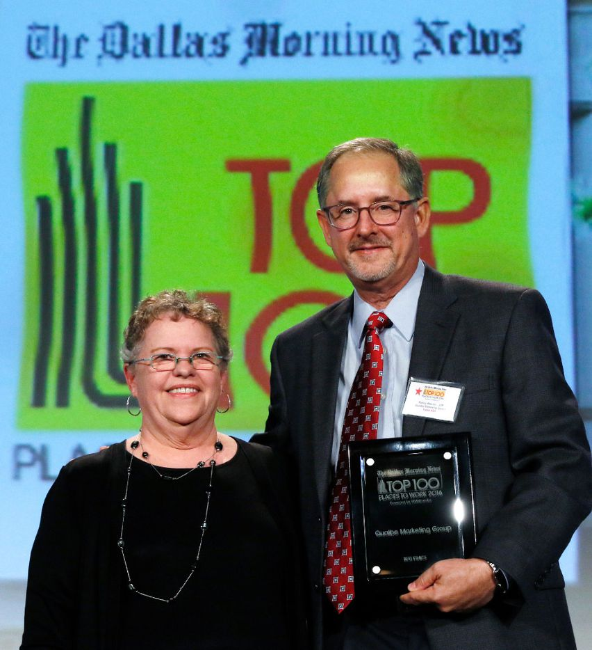 Laura Jacobus left, Dallas Morning News Top 100 Places to Work Editor poses with Randy Meinen, Qualbe Marketing Group during the Dallas Morning News Top 100 Places to Work luncheon at the Dallas Omni Hotel on Friday, November 17, 2016 in Dallas, Texas.  Qualbe Marketing Group won for best ethics. (David Woo/The Dallas Morning News)