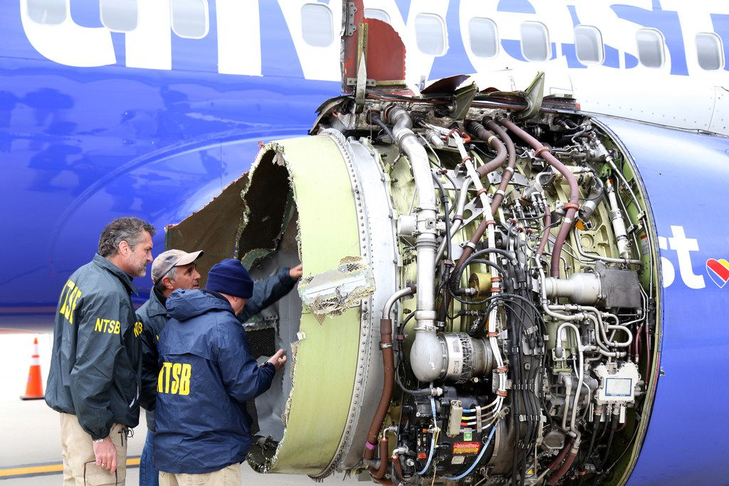 In this National Transportation Safety Board photo, NTSB investigators examine damage to Southwest Airlines Flight 1380.