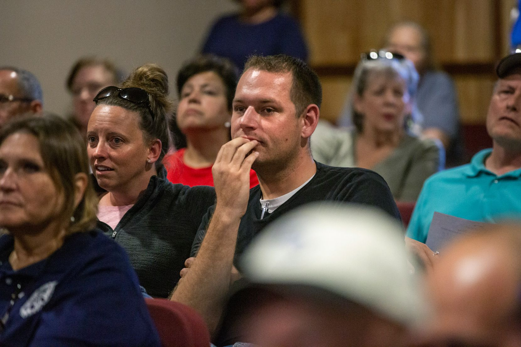 Frank Hall listens to council member comments during the city council meeting in Ferris, Texas, on Monday, Oct. 8, 2019. Monday's meeting included an agenda item to determine if the resignation of police chief Eddie Salazar would be accepted, and many attended the meeting to show support for Salazar.