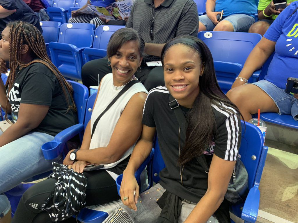 Guard Moriah Jefferson poses alongside her mother for a photo during the Wings 83-77 win over the New York Liberty on Friday at College Park Center.
