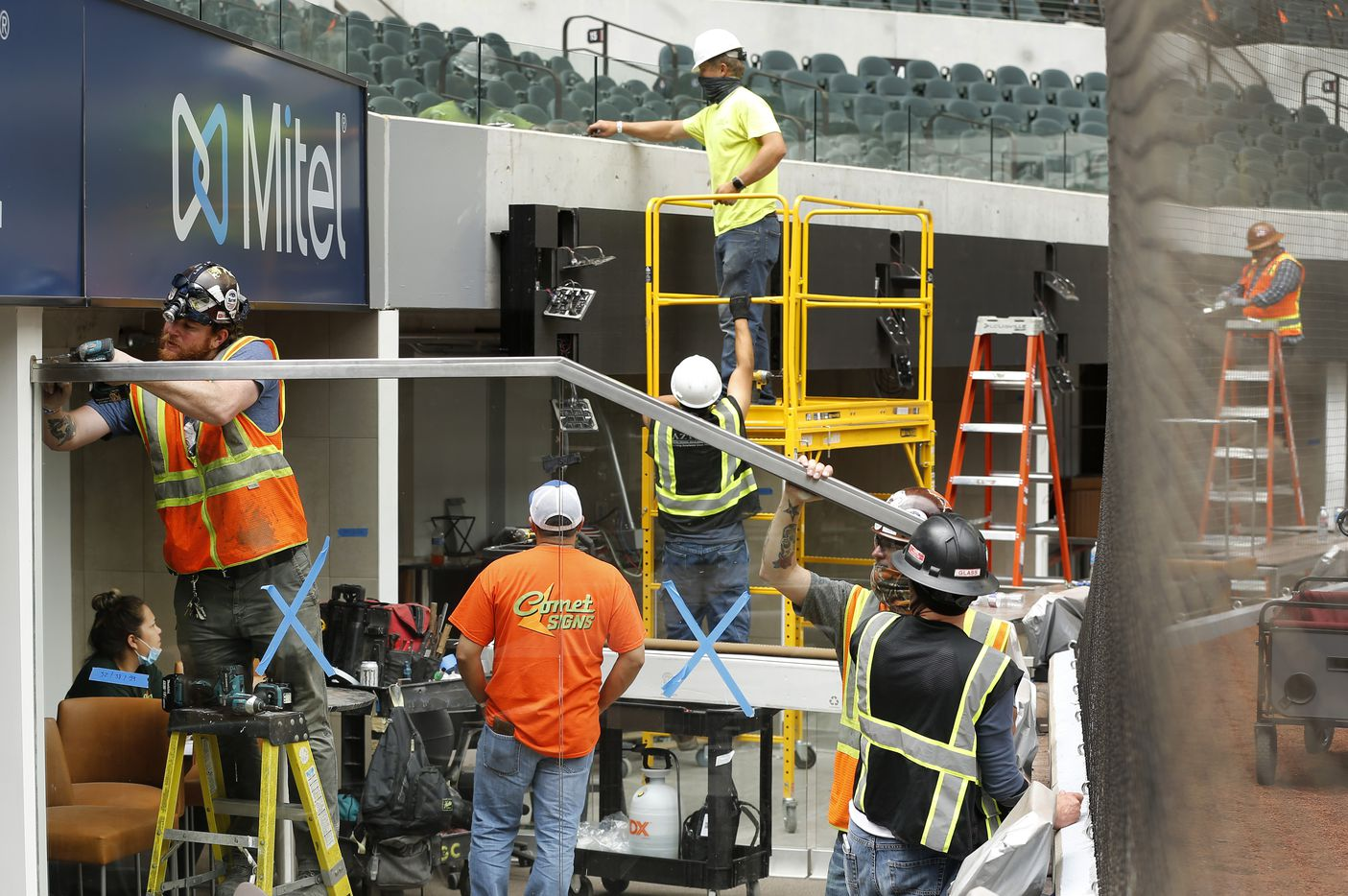 Construction workers finish out the field level suites behind home plate at the newly completed Globe Life Field in Arlington, Wednesday, May 20 2020. The stadium is getting ready to host several high school graduations in the coming weeks. (Tom Fox/The Dallas Morning News)