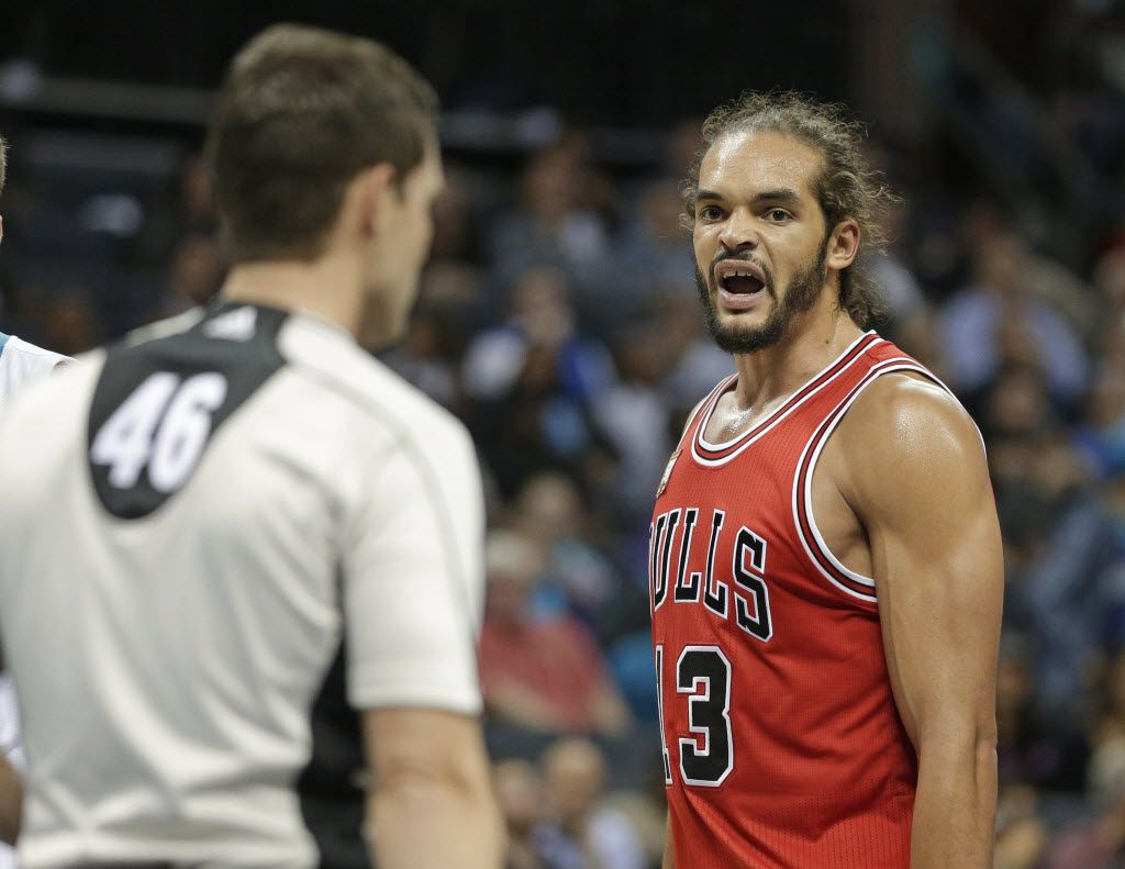 Chicago Bulls' Joakim Noah, right, argues a call with referee Ben Taylor, left, during the second half of an NBA basketball game against the Charlotte Hornets in Charlotte, N.C., Tuesday, Nov. 3, 2015. The Hornets won 130-105. (AP Photo/Chuck Burton)