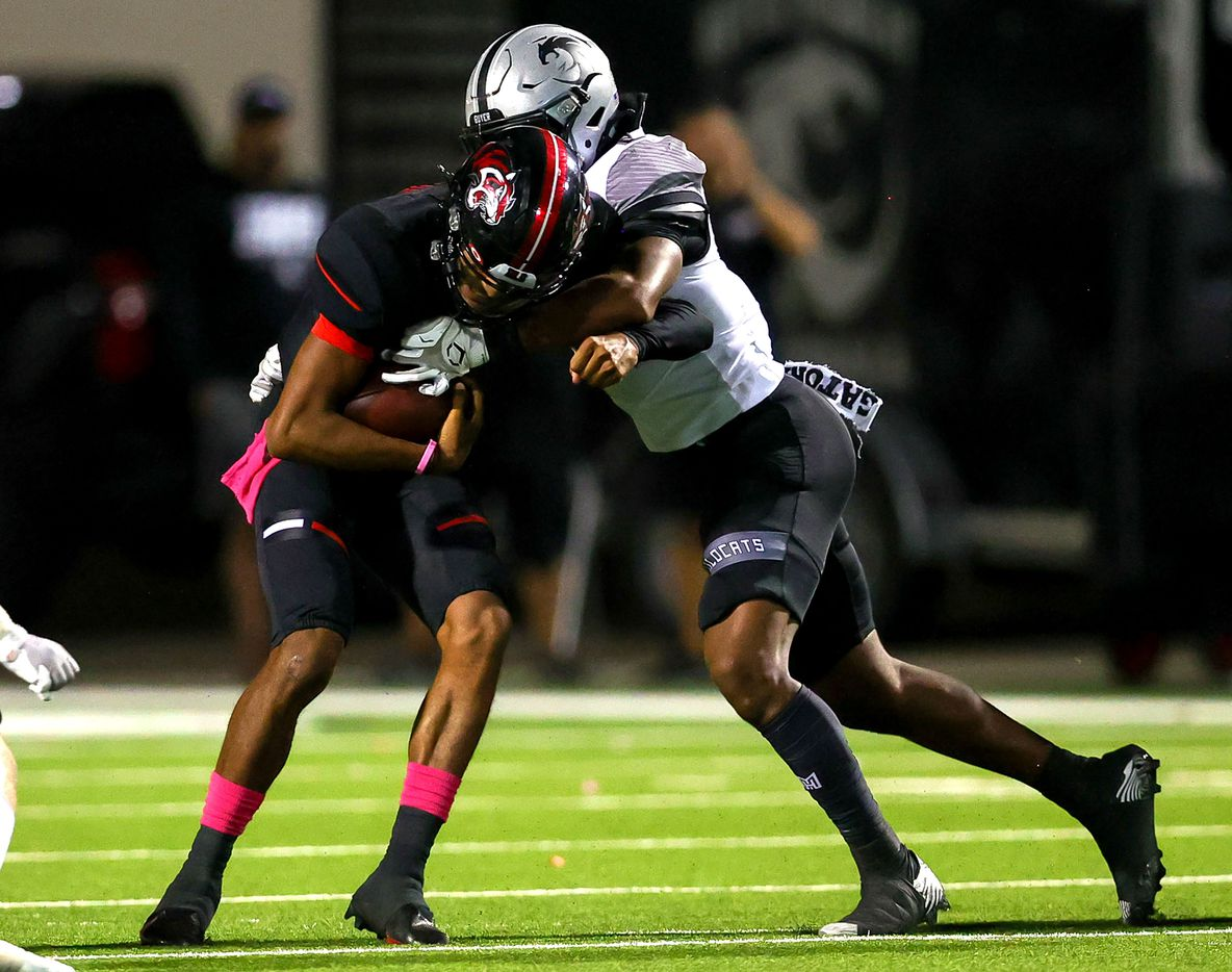 Denton Braswell quarterback Keegan Byrd (L) gets sacked by Denton Guyer defensive tackle Vincent Paige (R) during the first half in a District 5-6A high school football game played at the C.H. Collins Complex on Friday, October 8, 2021, in Denton. (Steve Nurenberg/Special Contributor)