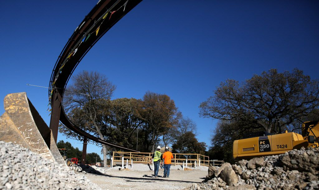 Men work construction below the monorail at the Simmons Hippo Outpost at the Dallas Zoo on Dec. 1, 2016.