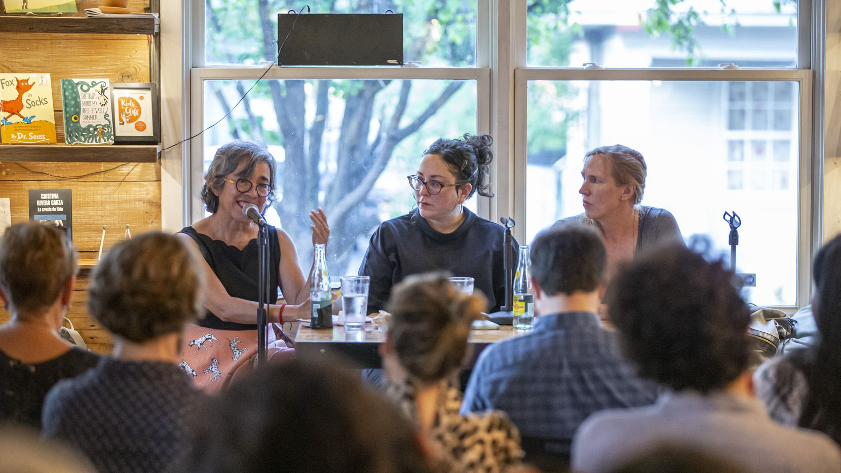 Attendees listen as authors Cristina Rivera Garza, left, Leni Zumas, center, and Miriam Toews speak at the Wild Detectives on Sept. 7, 2019 for the Hay Forum's second Dallas event. The third forum in 2020 will be virtual.