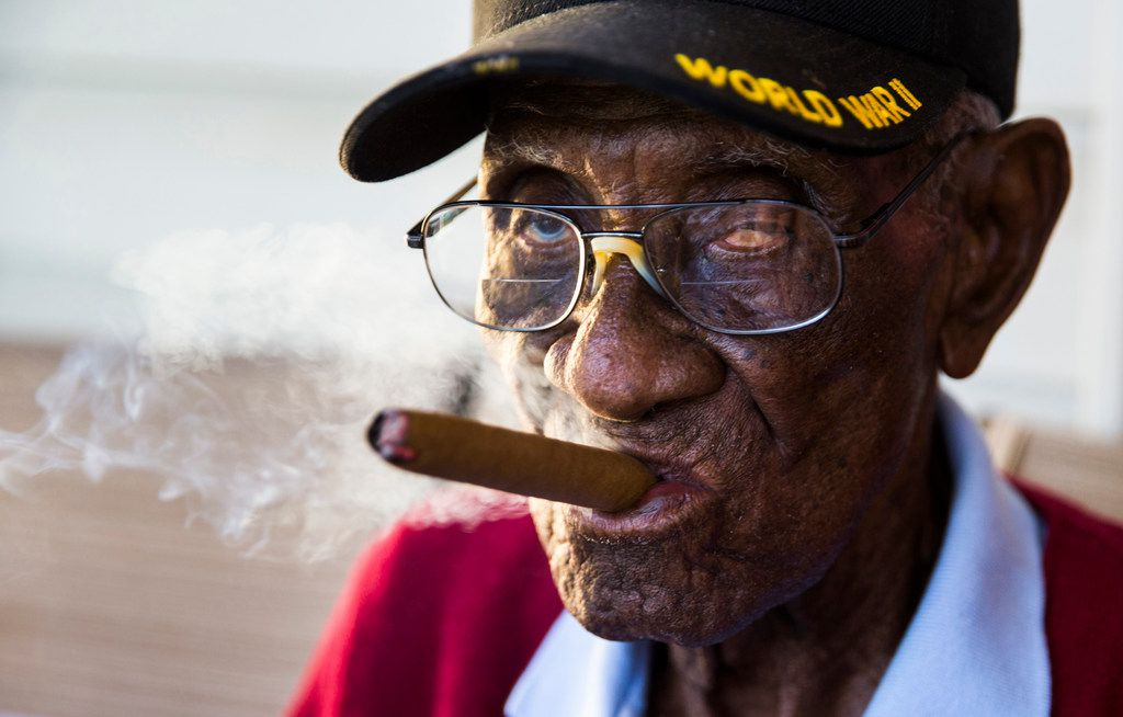 World War II veteran Richard Overton, 112, of Austin had his personal bank account emptied and his identity stolen.