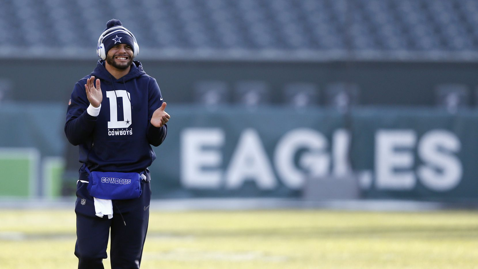 Dallas Cowboys quarterback Dak Prescott (4) claps as he walks up the field before warmups prior to a game against the Philadelphia Eagles at Lincoln Financial Field in Philadelphia on Sunday, December 22, 2019.
