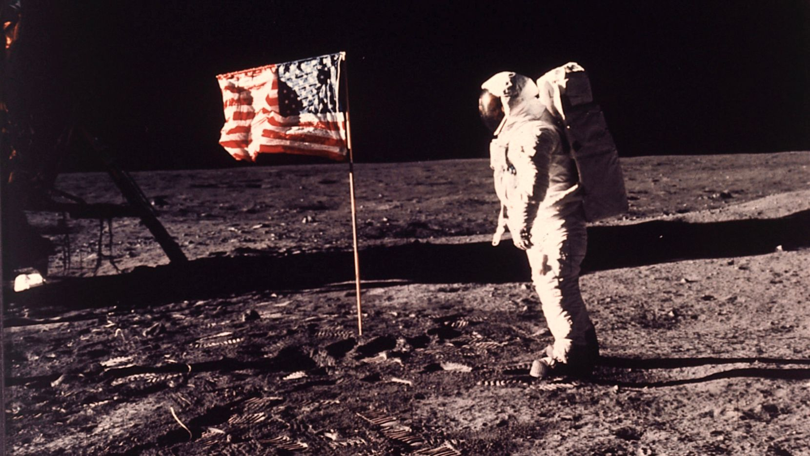 In this image provided by NASA, astronaut Buzz Aldrin poses for a photograph beside the U.S. flag deployed on the moon during the Apollo 11 mission on July 20, 1969.
