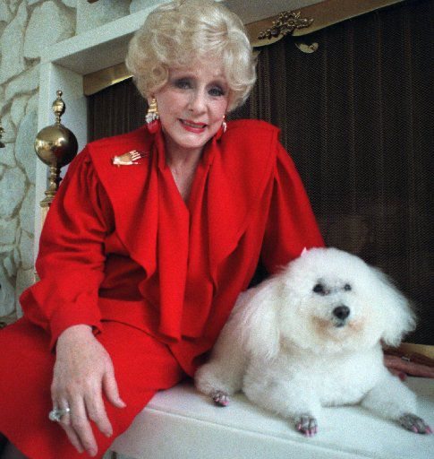Mary Kay Ash with her poodle Gigi.