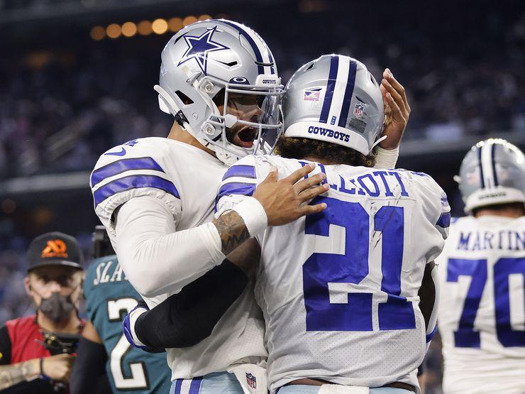Dallas Cowboys quarterback Dak Prescott (4) congratulators running back Ezekiel Elliott (21) on his first quarter touchdown against the Philadelphia Eagles at AT&T Stadium in Arlington, Monday, September 27, 2021.