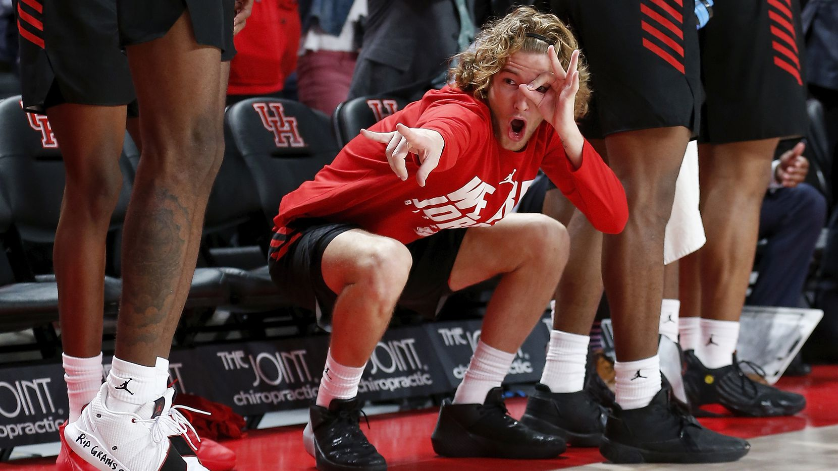 Houston Cougars guard Landon Goesling (2) celebrates on the bench after a three point shot during the second half of the NCAA basketball game between the Houston Cougars and the LSU Tigers at the Fertitta Center in Houston, TX on Wednesday, December 12, 2018.  Houston defeated LSU 82-76.