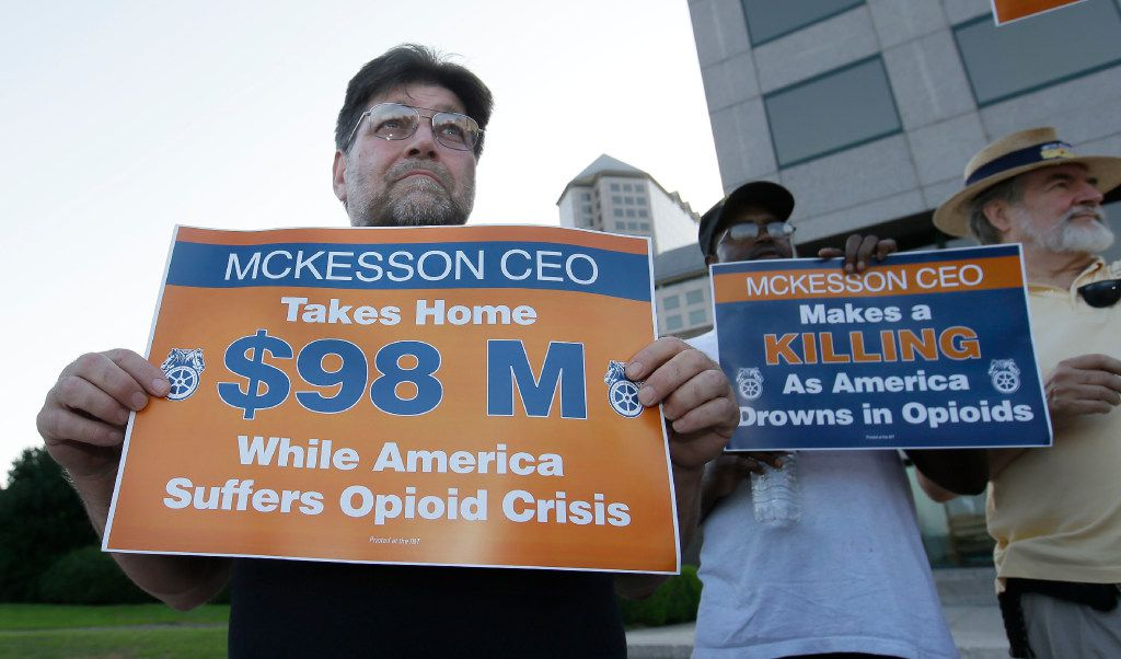 Randy McLain of Dallas, held a sign with Teamsters as they protested outside the McKesson Corp. shareholders meeting in Irving on Wednesday. (LM Otero/The Associated Press)