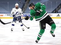 John Klingberg #3 of the Dallas Stars follows through on his shot as Nikita Kucherov #86 of the Tampa Bay Lightning looks on in the second period of Game Six of the NHL Stanley Cup Final between the Tampa Bay Lightning and the Dallas Stars at Rogers Place on September 28, 2020 in Edmonton, Alberta, Canada. (Photo by Dave Sandford/NHLI via Getty Images)