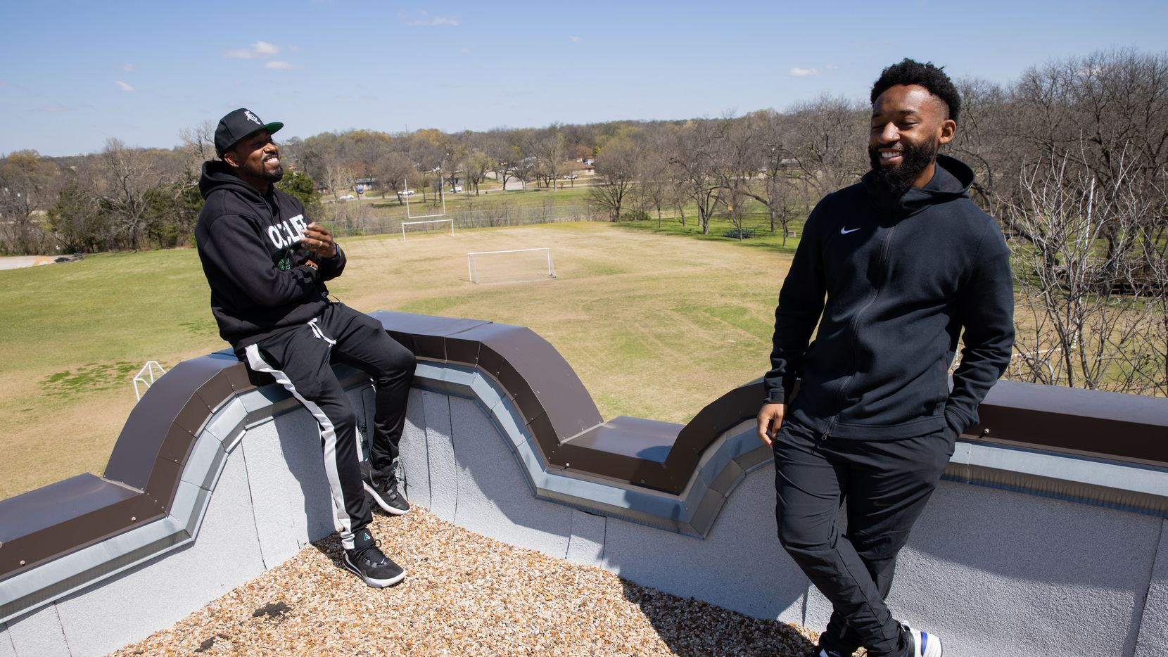 Taylor Toynes, left, For Oak Cliff executive director, and Xavier Henderson, director of strategy, took visitors onto the roof of the former Moorland YMCA in South Oak Cliff Friday.  Their nonprofit's move to this new space will provide 20,000 square feet of indoor space and a surrounding 10 acres for activities.