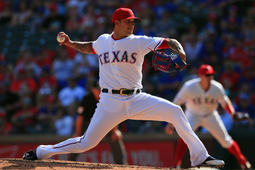 ARLINGTON, TX - APRIL 09:  Matt Bush #51 of the Texas Rangers throws against the Oakland Athletics in the eighth inning at Globe Life Park in Arlington on April 9, 2017 in Arlington, Texas.  (Photo by Ronald Martinez/Getty Images)