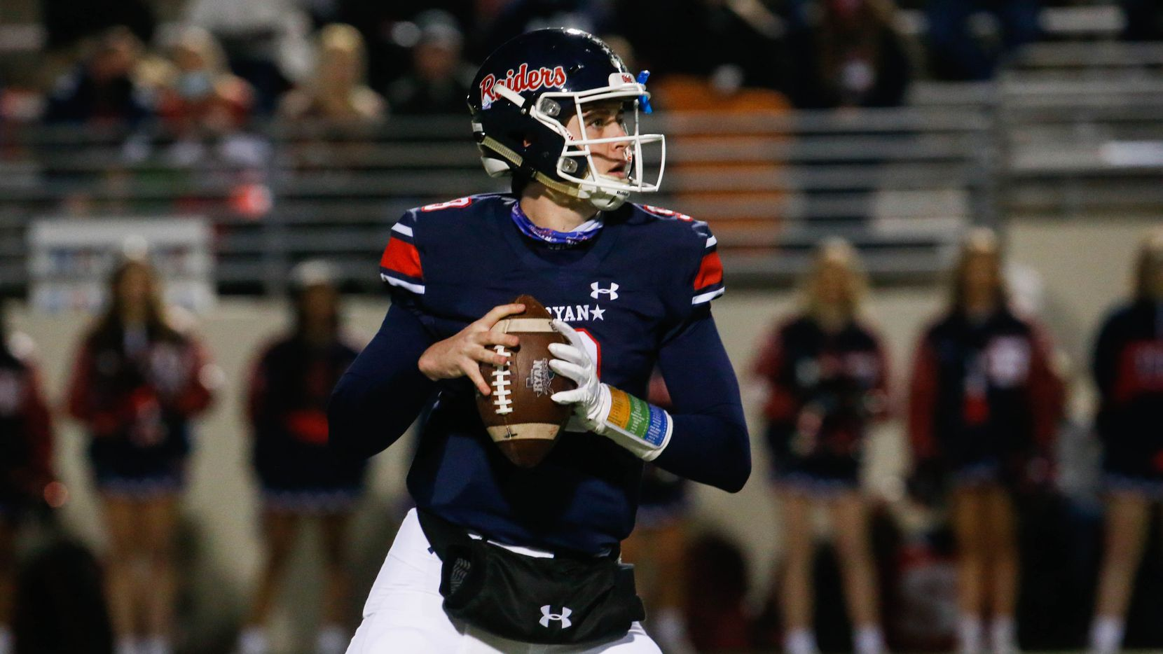 Denton Ryan's quarterback Seth Henigan (9) gets ready to throw the ball during the second quarter of a football game against Frisco Lone Star at the C.H. Collins Complex in Denton on Thursday, Dec. 4, 2020. The game is tied at halftime, 14-14.