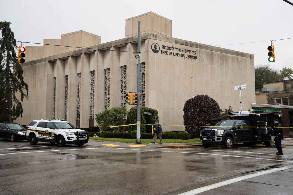 Police stand guard outside the Tree of Life Synagogue in Pittsburgh where a shooter opened fire Oct. 27, 2018. (AP Photo/Matt Rourke)