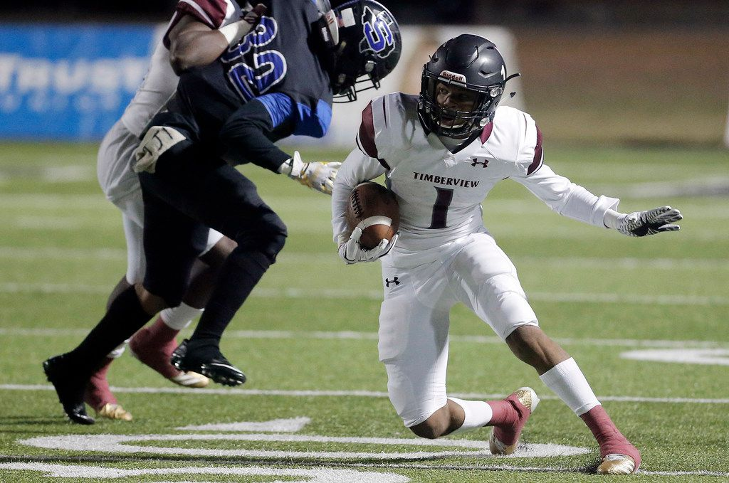 Mansfield Timberview running back Stacy Sneed (1) looks for room to run against the Mansfield Summit defense during a game in 2017. (Brandon Wade/Special Contributor)