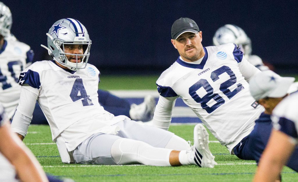 Dallas Cowboys quarterback Dak Prescott (4) and tight end Jason Witten (82) stretch during a Dallas Cowboys OTA practice on Wednesday, May 22, 2019 at The Star in Frisco. (Ashley Landis/The Dallas Morning News)