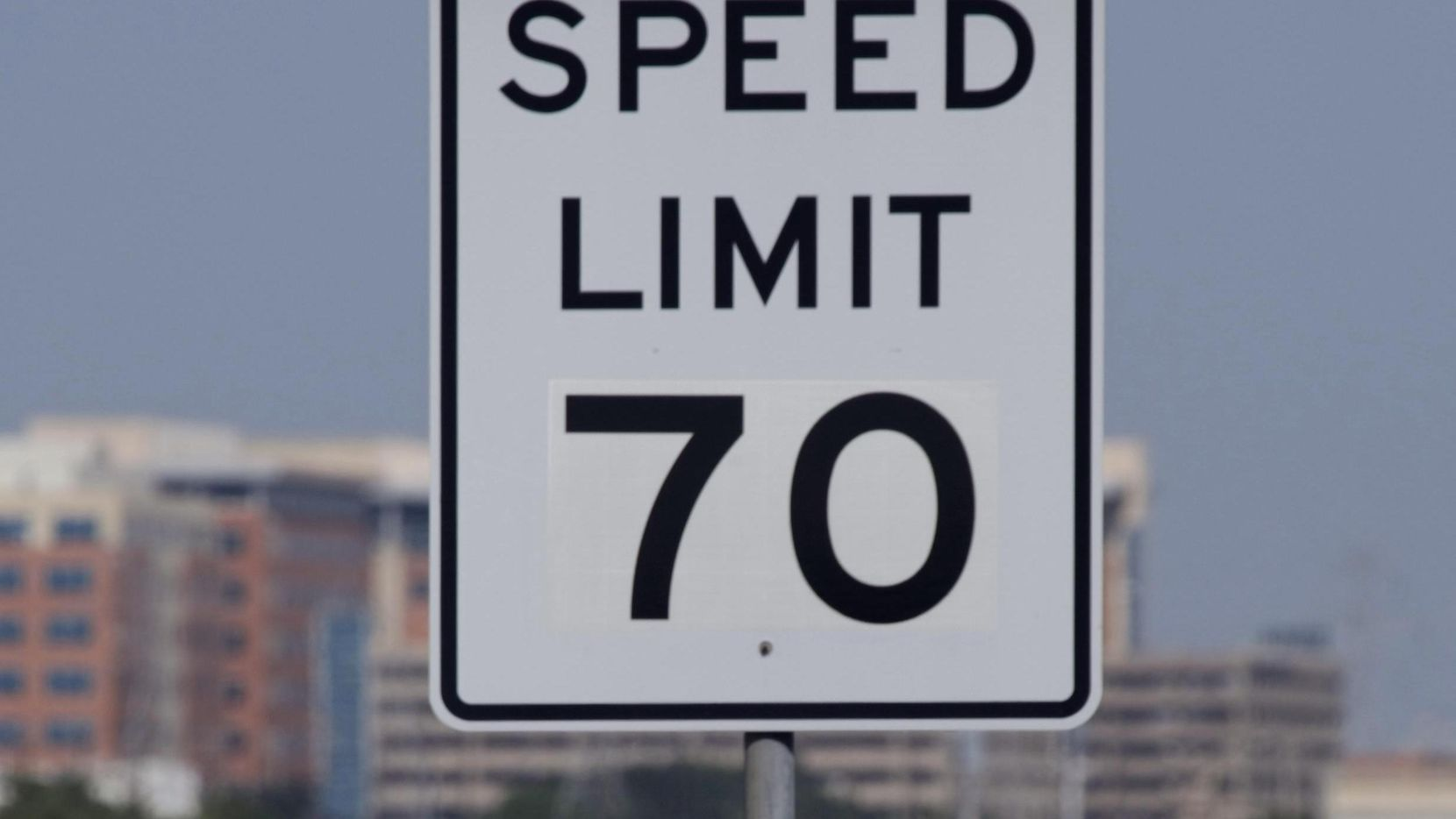 Eastbound drivers on the President George Bush Turnpike, just east of the Dallas North Tollway, pass 70 mph speed limit signs put up by North Texas Tollway Authority on August 24, 2009, in Dallas, Texas.