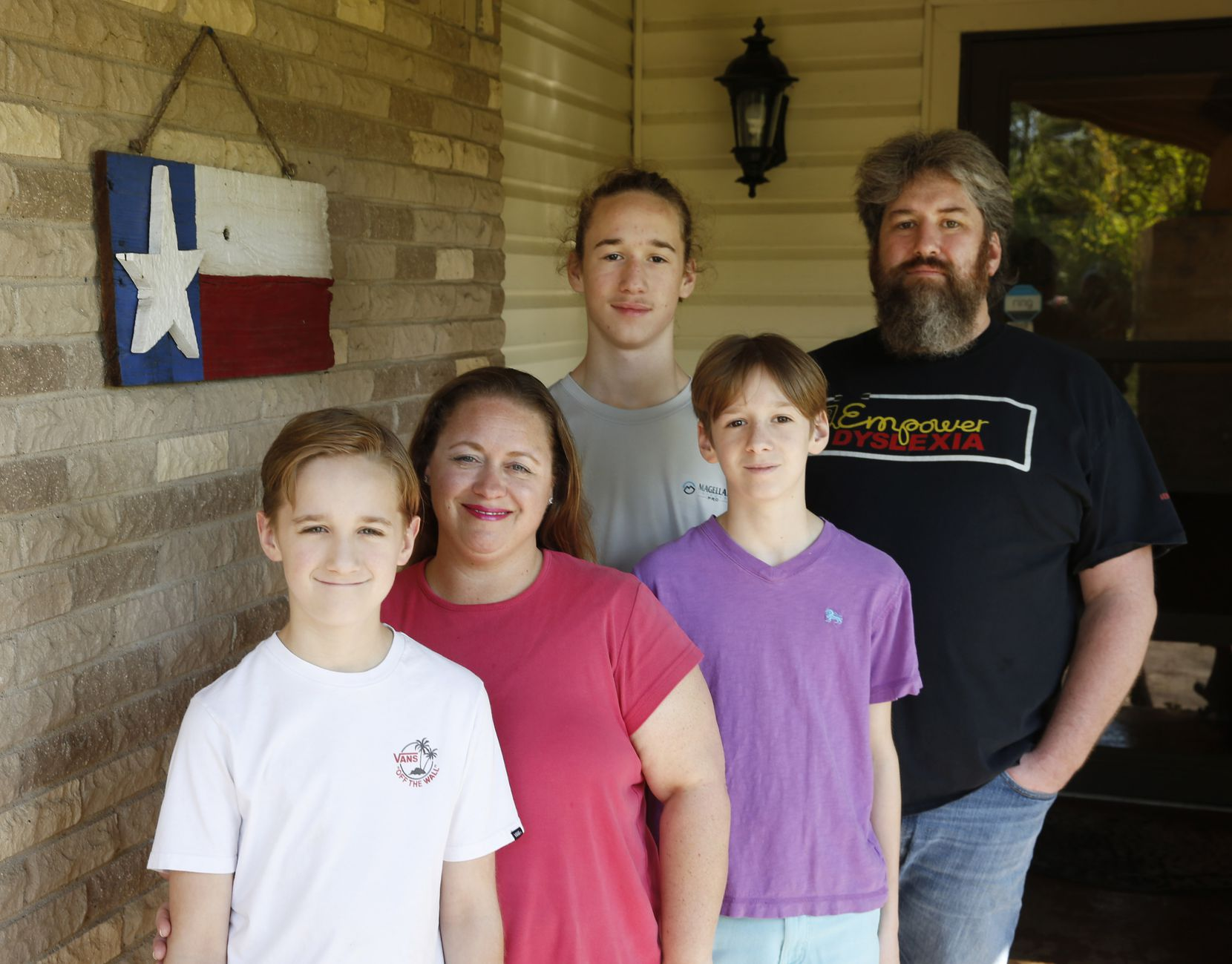 (from l to r) Ashton, 11; Amy; Asher, 15; Aden, 14; and Stephen Yearout pose for a portrait outside their home in Garland.