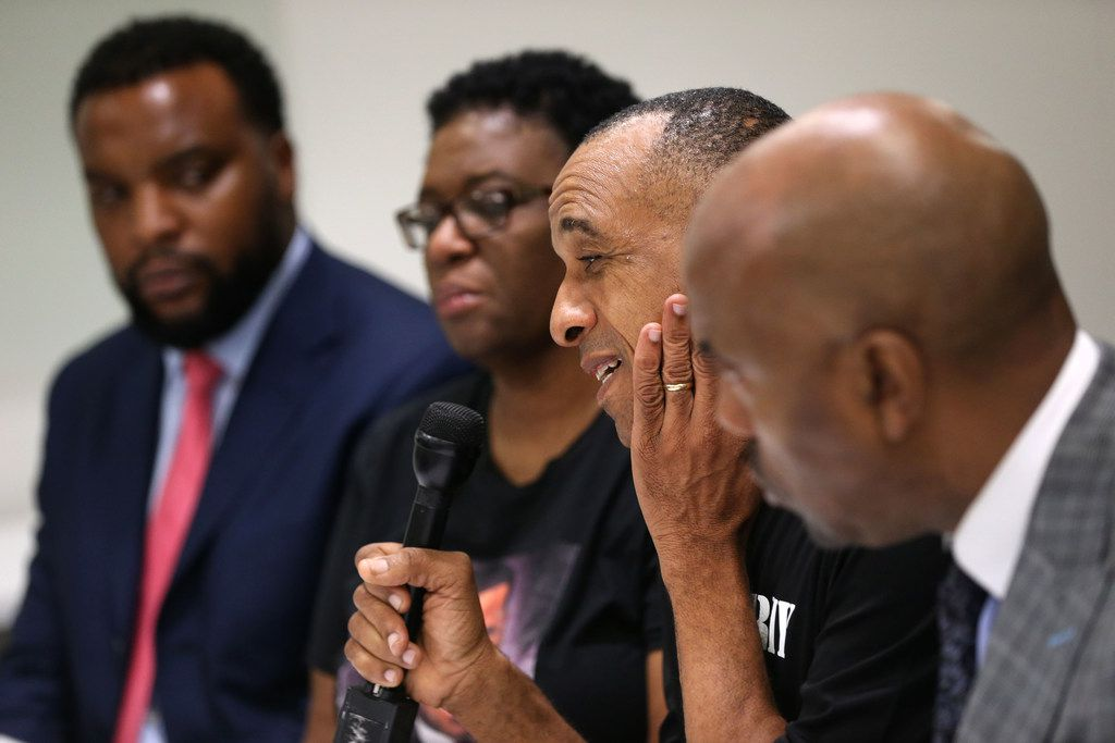 Bertrum Jean, the father of Botham Jean, speaks next to his wife, Allison Jean, and attorneys Lee Merritt (far left) and Daryl Washington (far right) during an interview in Dallas last week with The Dallas Morning News.